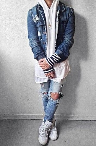 Opt for a trucker jacket and baby blue distressed skinny jeans for a comfortable outfit that's also put together nicely. White high top sneakers are the right shoes here to get you noticed.