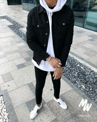 If you don't like trying-too-hard combinations, rock a black denim jacket with black slim jeans. Consider white leather low top sneakers as the glue that will bring your look together. If you feel uninspired by your transitional weather fashion options, this outfit just might be the inspiration you need.