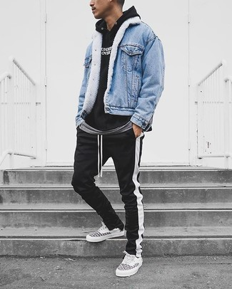 How to wear: light blue denim jacket, black and white print hoodie, grey crew-neck t-shirt, black and white vertical striped sweatpants