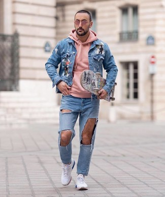 How to wear: light blue print denim jacket, pink hoodie, light blue ripped jeans, white athletic shoes