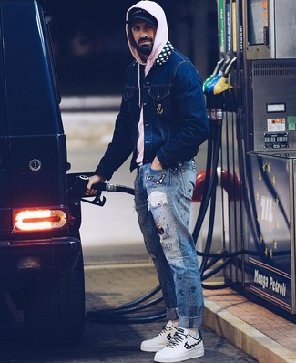 How to wear: navy denim jacket, pink hoodie, blue print jeans, white leather low top sneakers