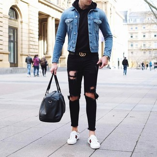 How to Wear a Blue Denim Jacket For Men: This relaxed casual pairing of a blue denim jacket and black ripped jeans is extremely easy to pull together without a second thought, helping you look on-trend and prepared for anything without spending too much time combing through your wardrobe. White leather low top sneakers will breathe an added dose of refinement into an otherwise standard outfit.