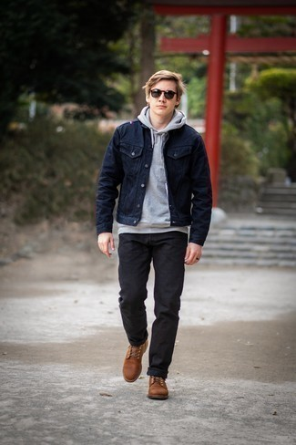 Navy Denim Jacket Outfits For Men: You'll be surprised at how super easy it is for any gentleman to pull together this casual ensemble. Just a navy denim jacket combined with black jeans. Ramp up your getup by finishing with brown leather casual boots.