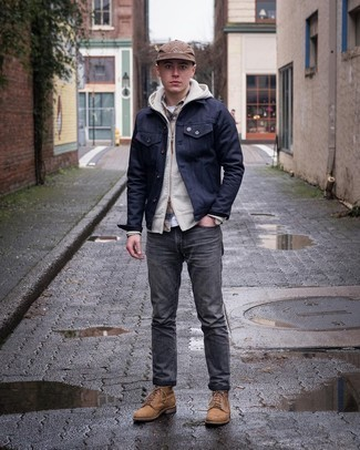 Charcoal Jeans Outfits For Men: A navy denim jacket and charcoal jeans are the kind of a tested casual outfit that you so desperately need when you have zero time. Tan suede casual boots will bring a dose of class to an otherwise utilitarian look.