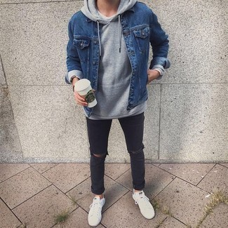 Charcoal Ripped Jeans Outfits For Men: A blue denim jacket and charcoal ripped jeans are worth adding to your list of essential casual items. Feeling transgressive? Jazz things up by wearing white and black canvas low top sneakers.