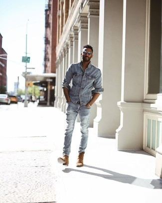 500+ Casual Outfits For Men: To achieve a laid-back look with an edgy finish, you can dress in a light blue denim jacket and light blue ripped jeans.