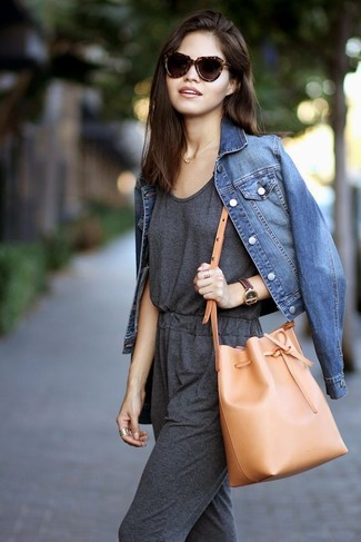 How to wear: blue denim jacket, charcoal jumpsuit, tan leather bucket bag, dark brown leopard sunglasses