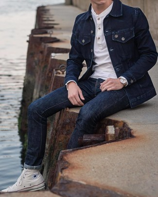 White Canvas High Top Sneakers Outfits For Men: This casual pairing of a navy denim jacket and navy jeans is a fail-safe option when you need to look great in a flash. Go off the beaten track and spice up your look by finishing with a pair of white canvas high top sneakers.