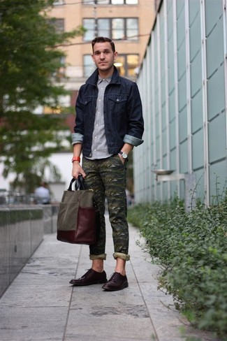 How to wear: navy denim jacket, grey long sleeve shirt, olive camouflage chinos, dark brown leather derby shoes