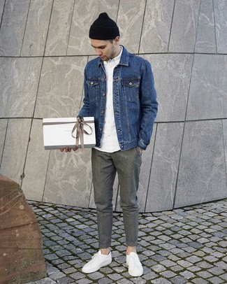 How to Wear a Blue Denim Jacket For Men: A blue denim jacket and grey wool chinos will give off this relaxed and dapper vibe. Introduce white leather low top sneakers to the mix to instantly boost the appeal of this look.