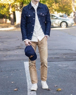 White Canvas High Top Sneakers Outfits For Men: If you prefer relaxed casual style, why not take this pairing of a navy denim jacket and khaki chinos for a walk? Have some fun with things and complete this getup with white canvas high top sneakers.