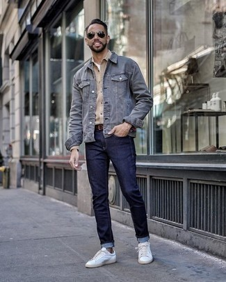 How to Wear a Blue Denim Jacket For Men: If you're looking for an off-duty but also seriously stylish look, dress in a blue denim jacket and navy jeans. White canvas low top sneakers look great here.