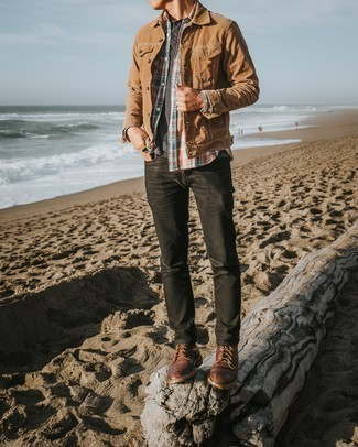 Men's Outfits 2020: A tan denim jacket and charcoal jeans paired together are a perfect match. Brown leather casual boots are guaranteed to infuse an added touch of style into your outfit.