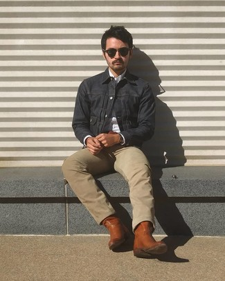 How to wear: navy denim jacket, white long sleeve shirt, beige jeans, brown leather cowboy boots