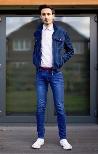 How to Wear a Navy Denim Jacket For Men: This combo of a navy denim jacket and blue jeans is extremely easy to achieve and so comfortable to sport as well! For something more on the daring side to finish off this outfit, add a pair of white canvas high top sneakers to the mix.