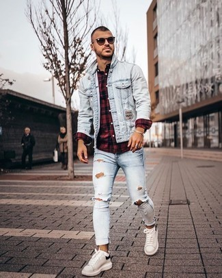 How to Wear Light Blue Ripped Skinny Jeans For Men: This casual street style pairing of a light blue denim jacket and light blue ripped skinny jeans is extremely easy to put together in no time flat, helping you look seriously stylish and prepared for anything without spending too much time rummaging through your closet. To bring a little classiness to this ensemble, introduce white and black leather low top sneakers to the mix.