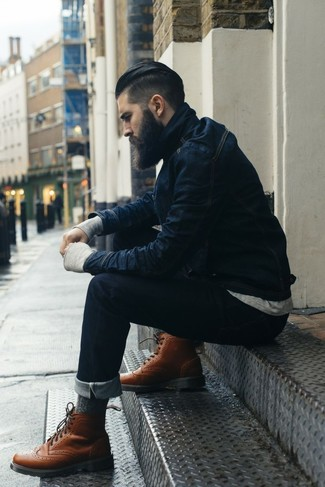 Choose a navy blue denim jacket and deep blue jeans to get a laid-back yet stylish look. Grab a pair of brown leather brogue boots to show your sartorial savvy.