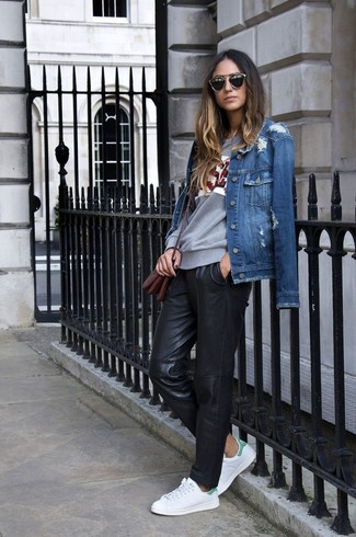 A blue denim jacket and black leather casual pants are your go-to outfit for lazy days. Round off this look with white low top sneakers.