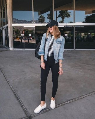 How to Wear White Slip-on Sneakers For Women: A light blue denim jacket and black skinny jeans paired together are a total eye candy for those who appreciate cool chic ensembles. This look is complemented perfectly with a pair of white slip-on sneakers.