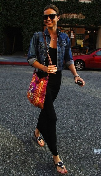 Miranda Kerr wearing Blue Denim Jacket, Black Maxi Dress, Black Leather Thong Sandals, Hot Pink Print Canvas Crossbody Bag