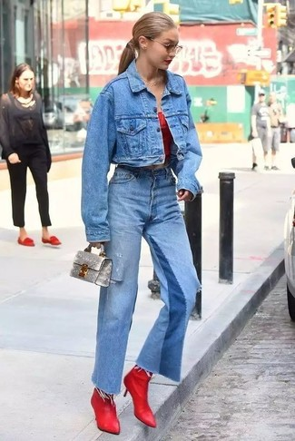 How to wear: blue denim jacket, red off shoulder top, blue flare jeans, red leather ankle boots