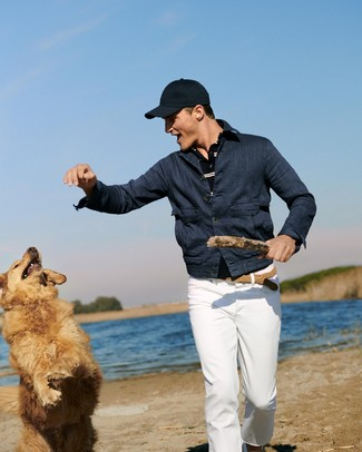 How to wear: navy denim jacket, navy horizontal striped polo, white chinos, navy baseball cap
