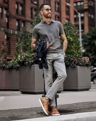 How to Wear Silver Sunglasses For Men: Pair a navy denim jacket with silver sunglasses for equally stylish and easy-to-wear look. For something more on the dressier side to round off this ensemble, complete your outfit with a pair of brown leather low top sneakers.