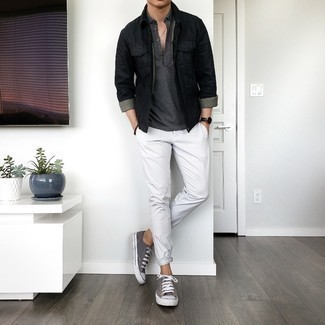 Men's Outfits 2021: For a look that's pared-down but can be styled in a myriad of different ways, wear a black denim jacket and white chinos. And if you need to effortlessly dress down this outfit with a pair of shoes, complete your ensemble with a pair of charcoal canvas low top sneakers.