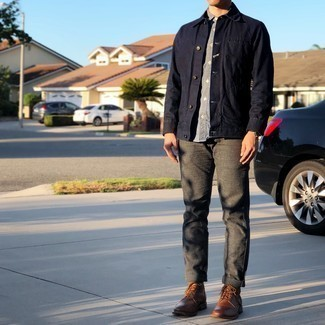 Brown Leather Casual Boots Outfits For Men: Pair a navy denim jacket with charcoal chinos to pull together a seriously stylish and modern-looking relaxed casual outfit. A cool pair of brown leather casual boots is the simplest way to punch up this ensemble.