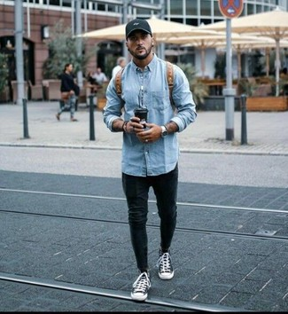 How to wear: light blue denim jacket, black skinny jeans, black and white canvas high top sneakers, brown leather backpack