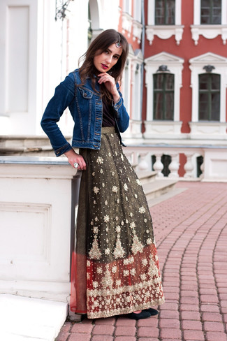 A black silk sleeveless top and a dark green embroidered maxi skirt is a wonderful combination to add to your casual lineup. Take a classic approach with the footwear and rock a pair of black suede pumps. Can you see how very easy it is to look seriously stylish and stay warm when cooler days are here, thanks to this look?