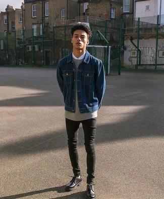 How to wear: navy denim jacket, grey sweatshirt, white dress shirt, black skinny jeans