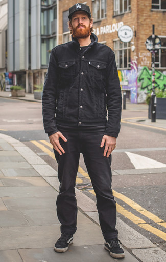 How to Wear a Black Denim Jacket For Men: If it's comfort and practicality that you appreciate in menswear, choose a black denim jacket and black jeans. Black and white canvas low top sneakers pull the ensemble together.