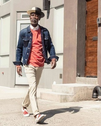 Fashion for Men Over 50: What To Wear: A navy denim jacket and beige chinos will bring serious style to your day-to-day casual routine. Red and white canvas slip-on sneakers integrate nicely within a myriad of combos. So if you're looking for style ideas on how to dress as you step into your 50s, this outfit is definitely worth saving for later.