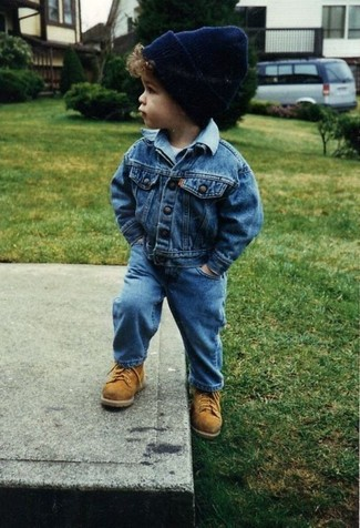 How to Wear Blue Jeans In Spring For Boys: Suggest that your son pair a blue denim jacket with blue jeans for a fun day out at the playground. As far as footwear is concerned, suggest that your little one throw in a pair of tan boots.