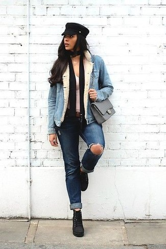 This pairing of a light blue denim jacket and a black scarf gives off a very casual and approachable vibe. And it's a wonder what a pair of black suede lace-up ankle boots can do for the look. This outfit is super functional and will help you out in transeasonal weather.