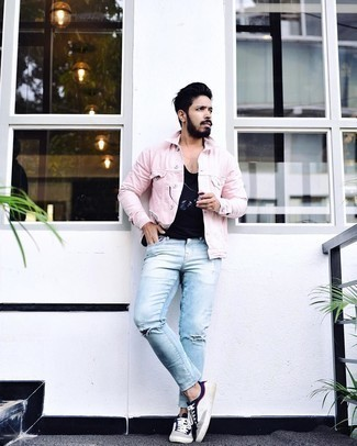 Denim Jacket Outfits For Men: Pair a denim jacket with light blue ripped jeans if you're scouting for an outfit option that speaks relaxed style. Not sure how to finish off your ensemble? Wear white and navy canvas low top sneakers to class it up.