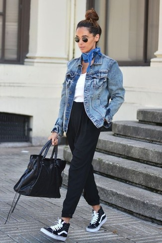 Make a blue denim jacket and black tapered pants your outfit choice to create a chic, glamorous look. Go for a pair of black high top sneakers for a more relaxed feel.