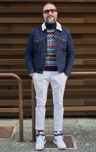 How to Wear a Navy Denim Jacket For Men: To assemble a casual ensemble with a clear fashion twist, try pairing a navy denim jacket with white chinos. On the fence about how to finish? Introduce a pair of white and black leather high top sneakers to your look for a more relaxed take.