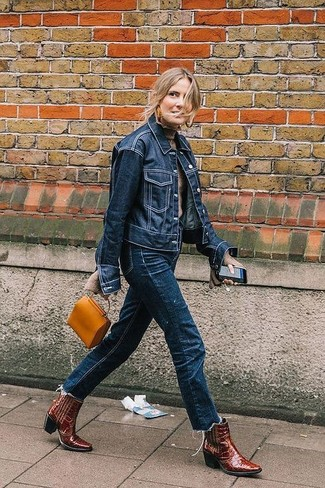 How to wear: navy denim jacket, beige turtleneck, navy jeans, burgundy leather cowboy boots