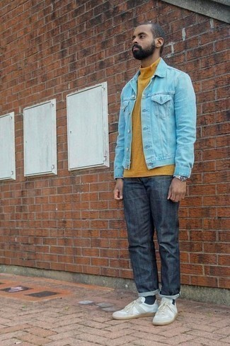 How to Wear a Light Blue Denim Jacket For Men: Who said you can't make a fashionable statement with an off-duty look? Make women go weak in the knees in a light blue denim jacket and navy jeans. Our favorite of a multitude of ways to complete this outfit is white canvas low top sneakers.