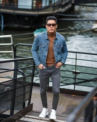 Black Leather Belt Outfits For Men: To don an off-duty look with a fashionable spin, wear a blue denim jacket with a black leather belt. Hesitant about how to finish this getup? Wear a pair of white leather low top sneakers to rev up the fashion factor.