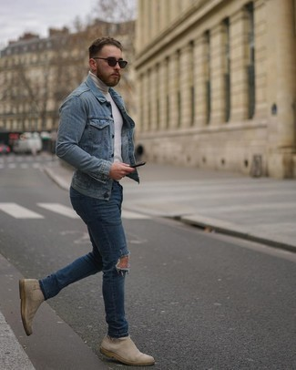 Blue Ripped Jeans Outfits For Men: Teaming a light blue denim jacket and blue ripped jeans will hallmark your skills in men's fashion even on off-duty days. Go the extra mile and break up your look with a pair of beige suede chelsea boots.