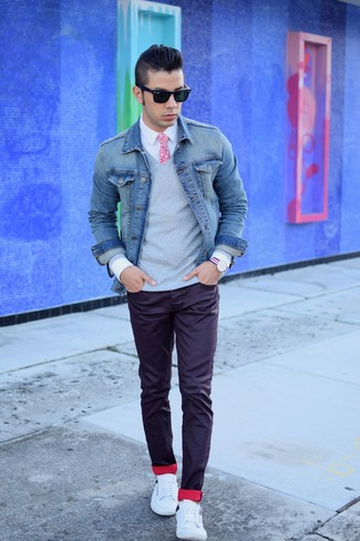 Busy days call for a simple yet stylish outfit, such as a grey v-neck pullover and dark purple jeans. Round off this look with white low top sneakers.