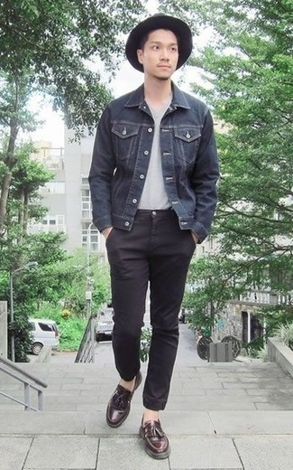 How to Wear Burgundy Leather Tassel Loafers: This off-duty pairing of a charcoal denim jacket and black chinos is very easy to throw together in no time flat, helping you look stylish and ready for anything without spending too much time searching through your wardrobe. Add a pair of burgundy leather tassel loafers to the equation for an extra touch of style.