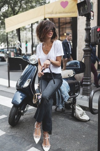 A light blue denim jacket and black flare jeans will showcase your sartorial self. Got bored with this outfit? Enter white studded leather pumps to change things up a bit. This one will play especially well when spring arrives.