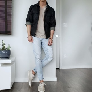 Men's Outfits 2021: This combination of a black leather shirt jacket and light blue ripped jeans embodies comfort without compromising style. Grey canvas low top sneakers integrate effortlessly within a great deal of combos.