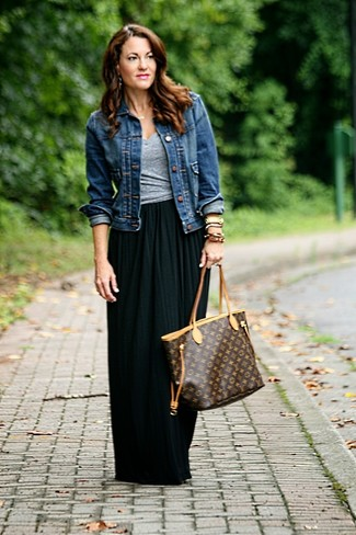How to wear: navy denim jacket, grey v-neck t-shirt, black pleated maxi skirt, dark brown print leather tote bag