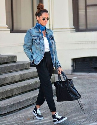 Nail glam in a blue jean jacket and black tapered pants. Opt for a pair of black canvas high top sneakers for a more relaxed feel. This is a foolproof option for an easy-to-transition ensemble.