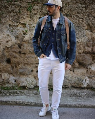 Brown Leather Backpack Outfits For Men: Pairing a navy denim jacket with a brown leather backpack is an on-point option for a casual outfit. Want to break out of the mold? Then why not add a pair of white and green leather low top sneakers to your outfit?